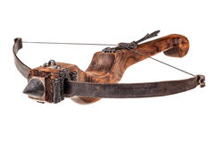 Old Crossbow. An ancient medieval crossbow isolated over a white background Royalty Free Stock Photo