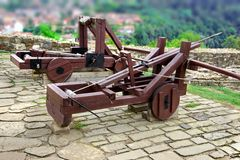 Old Crossbow and catapult in Tsarevets fortress,  Bulgaria, Veli. Old Large Wooden Crossbow and Catapult in Tsarevets fortress,  Bulgaria, Veliko Tarnovo Stock Photos