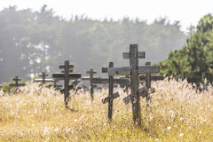 Old crosses at the historic orthodox cemetery of Fort Ross. Old wooden crosses at the historic orthodox cemetery of Fort Ross Stock Photo