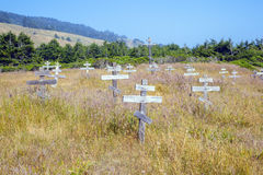 Old crosses at the historic orthodox cemetery of Fort Ross. Old wooden crosses at the historic orthodox cemetery of Fort Ross Stock Photography
