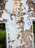 Old crucifix gravestone. With cracked whitewashed surface Stock Image