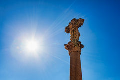 Old crucifix with sun rays Royalty Free Stock Photo