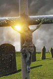 Old crucifixion and cemetery. With dark sky Stock Photos