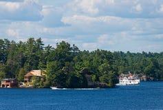 Old cruise ship on Lake Muskoka. Cruising alongside cottages on Lake Muskoka, Ontario Royalty Free Stock Photos