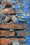 Old Crumbling Brick Wall Background. An old brick wall with blue paint crumbling off it stock images