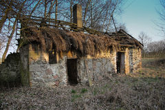 Old crumbling cottage. Old derelict crumbling cottage with chimney Stock Photography