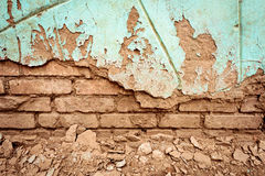 Old Crumbling Red Brick Wall and Green Paint Royalty Free Stock Images