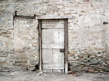 Old Crumbling Rock Wall with a Door. Royalty Free Stock Photography