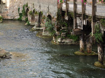 Old crumbling stone and wooden bridge Stock Photos