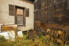 Old, crumbling wood building, with brown door, Jackson, Wyoming. Royalty Free Stock Photography