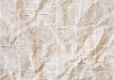 Old crumpled newspaper texture background. Old crumpled grunge newspaper paper texture background. Blurred vintage newspaper background. Crumpled paper textured royalty free stock photography