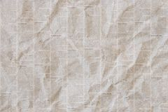 Old crumpled newspaper texture background. Old crumpled grunge newspaper paper texture background. Blurred vintage newspaper background. Crumpled paper textured Stock Image