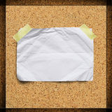 Old crumpled paper on cork background Stock Photography