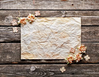 Old crumpled paper with dried flowers Royalty Free Stock Photography
