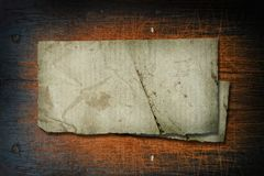 Old Crumpled Paper on old wooden background stock photography