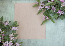 Old crumpled paper with purple flowers on grunge background Royalty Free Stock Photo