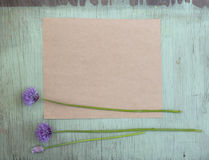 Old crumpled paper with purple flowers on grunge background Royalty Free Stock Images