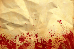 Old crumpled paper with red blood splash Stock Image