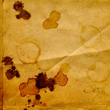 Old crumpled paper with stains of coffee. Or tea royalty free stock image