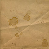 Old crumpled paper with stains of coffee Stock Images