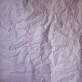 Old crumpled paper vintage texture. Rough wrinkled pink purple color shadows sheet. Textured grunge background with copy. Space royalty free stock image