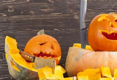 Old crumpled pumpkin. Old crumpled shabby pumpkin for use in the Halloween holiday closeup stock photo