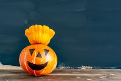 Old crumpled shabby pumpkin for use in the Halloween holiday closeup stock image