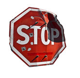 Old crumpled stop sign with bullet holes. Crumpled stop sign with bullet holes Stock Images