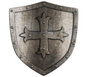 Old crusader metal shield with cross isolated. Old crusader metal shield illustration isolated on white Royalty Free Stock Photo