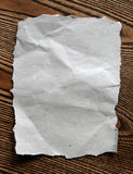 The old crushed paper. Lies on a wooden table Stock Photo