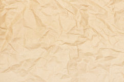 Old crushed paper background. Textured striped crumpled packaging brown paper background Royalty Free Stock Photos