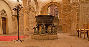 The old crypt. BREMEN, GERMANY - NOVEMBER 21, 2012: The medieval crypt of St Peter's cathedral with the Celtic-era cauldron, decorated with men sitting on lions stock photography