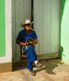 Old Cuban man with a dog and cigar in Trinidad, Cuba Stock Images