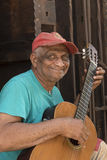 Old cuban man playing guitar Havana stock photo