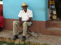 Old cuban man smoking a huge handmade cigar Stock Image