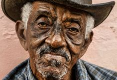Old Cuban right looks into the camera. stock photo