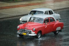 Old Cuban Taxi Racing. Old style taxi in Cuba at the rainy weather stock images