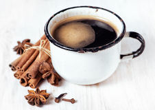 Old cup of coffee and spices Stock Photos