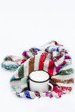 Old cup of hot cocoa with marshmallows and a soft colorful knitt Royalty Free Stock Images
