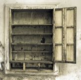 Old cupboard in abondend house. Toned image stock photos