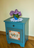 The old cupboard with flower Stock Images