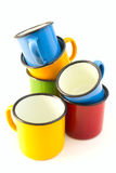 Old cups. A group of brightly coloured old tin cups Royalty Free Stock Photos