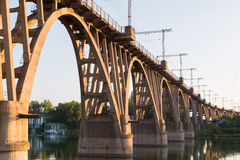 Old curved  railway bridge over river Dnieper . Dnepropetrovsk. Stock Photography