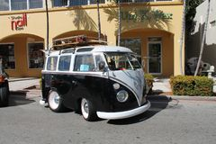 Old customized toyish-looking VW Microvan. Old Volkswagen Microbus parked outside on a sunny Miami day royalty free stock photography