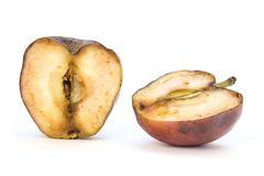 Old cut Apple. Old apple cut in two half on white background Stock Photos