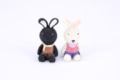 Old cute black and white rabbit polyresin doll isolated Royalty Free Stock Photos