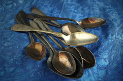 Old cutlery. For a blue background Royalty Free Stock Photo