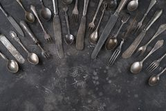 Old cutlery on a dark background royalty free stock photos