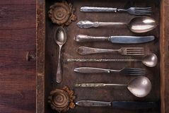 Old cutlery in an old wooden box Royalty Free Stock Photos