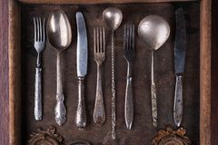 Old cutlery in a old wooden box Royalty Free Stock Photography